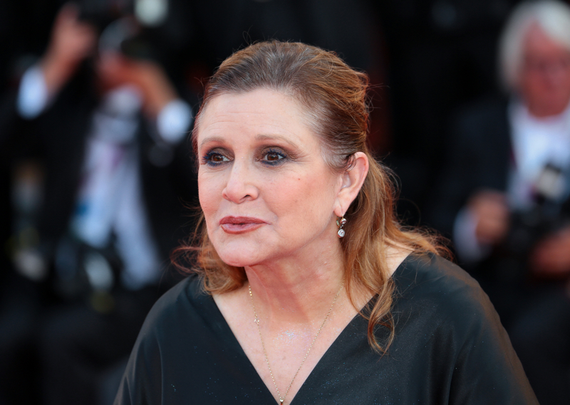 Memoir-writing advice from Carrie Fisher - pictured here at the Venice International Film Festival, 2012